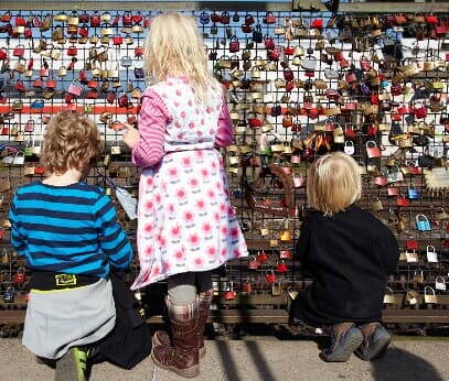 Children look at the love locks at the Hohenzollern Bridge in Cologne